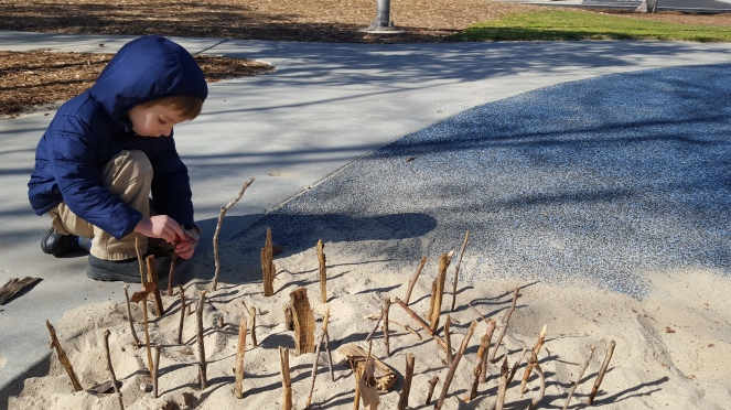 preschooler, sand play, forts in sand, creative play, park, sensory play